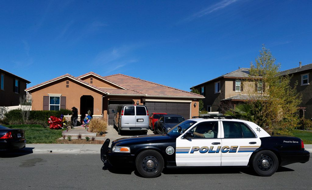 A Perris police car drives past the home of David and Louise Turpin where police arrested the couple accused of holding 13 children captive Wednesday, Jan. 24, 2018 in Perris, Calif. The Turpins are accused of abusing their 13 children, ranging from 2 to 29, before they were rescued on Jan. 14 from their home in Perris. The California children who authorities say were tortured by their parents and so malnourished that their growth was stunted are slowly providing valuable information to investigators, a prosecutor told The Associated Press on Wednesday.