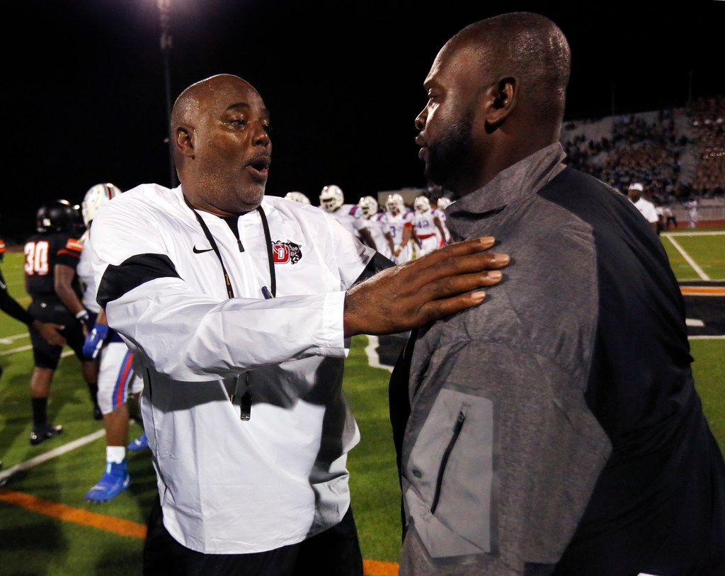 Duncanville head coach Reginald Samples (left) is congratulated by Lancaster head coach Christopher Gilbert at Beverly D. Humphrey Tiger Stadium in Lancaster Texas, Friday, August 30, 2019. Duncanville defeated Lancaster, 24-3. (Tom Fox/The Dallas Morning News)