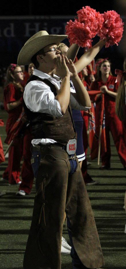 "A student is dressed as ""Rebel Man"" during a 2014 game for Richland High School. Birdville school trustees are expected to decide whether or not to shed the use of the mascot with a Confederate history."