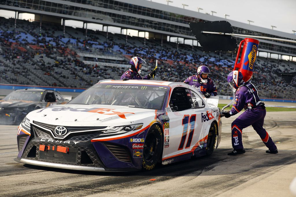 NASCAR driver Denny Hamlin of the No. 11 FedEx Office Toyota receives a late race splash of gas before going on to win the O'Reilly Auto Parts 500 race at the Texas Motor Speedway in Fort Worth, Sunday, March 31, 2019.