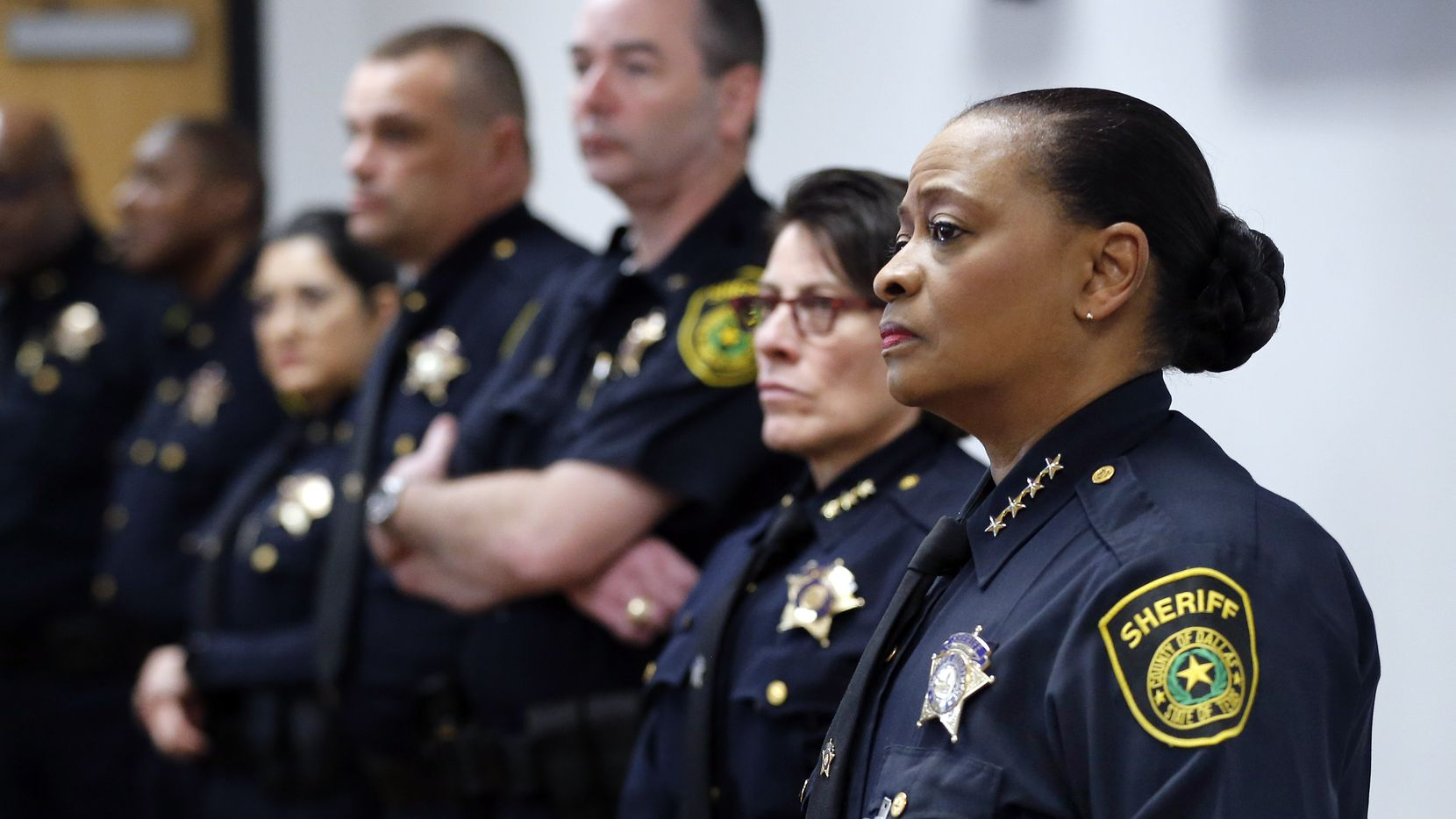 Alongside her deputies, Dallas County Sheriff Marian Brown listens during a press conference about the arrest of one of their own, deputy Austin Palmer, 33, during a press conference at the Frank Crowley Courts Building in Dallas, Friday, January 17, 2020.  Palmer was booked on charges of assault causing bodily injury and official oppression, Thursday, both are misdemeanors. The Sheriff explained Palmer mistreated a man in custody during a Òprisoner transport. He has since bonded out. (Tom Fox/The Dallas Morning News)