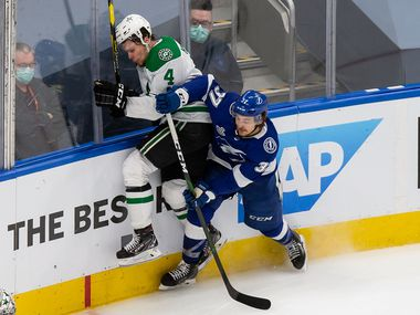Miro Heiskanen (4) of the Dallas Stars collides with Yanni Gourde (37) of the Tampa Bay Lightning during Game Two of the Stanley Cup Final at Rogers Place in Edmonton, Alberta, Canada on Monday, September 21, 2020. (Codie McLachlan/Special Contributor)