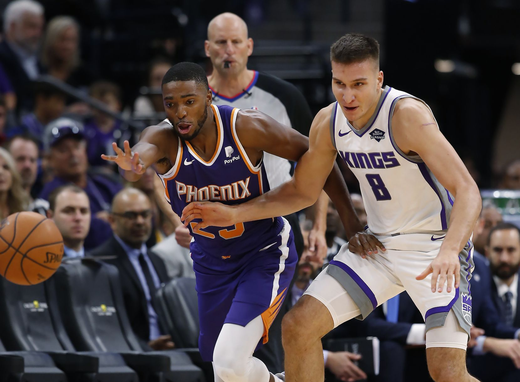Phoenix Suns forward Mikal Bridges, left, and Sacramento Kings guard Bogdan Bogdanovic scramble for the ball during the second half of an NBA preseason basketball game in Sacramento, Calif., Thursday, Oct. 10, 2019. (AP Photo/Rich Pedroncelli)