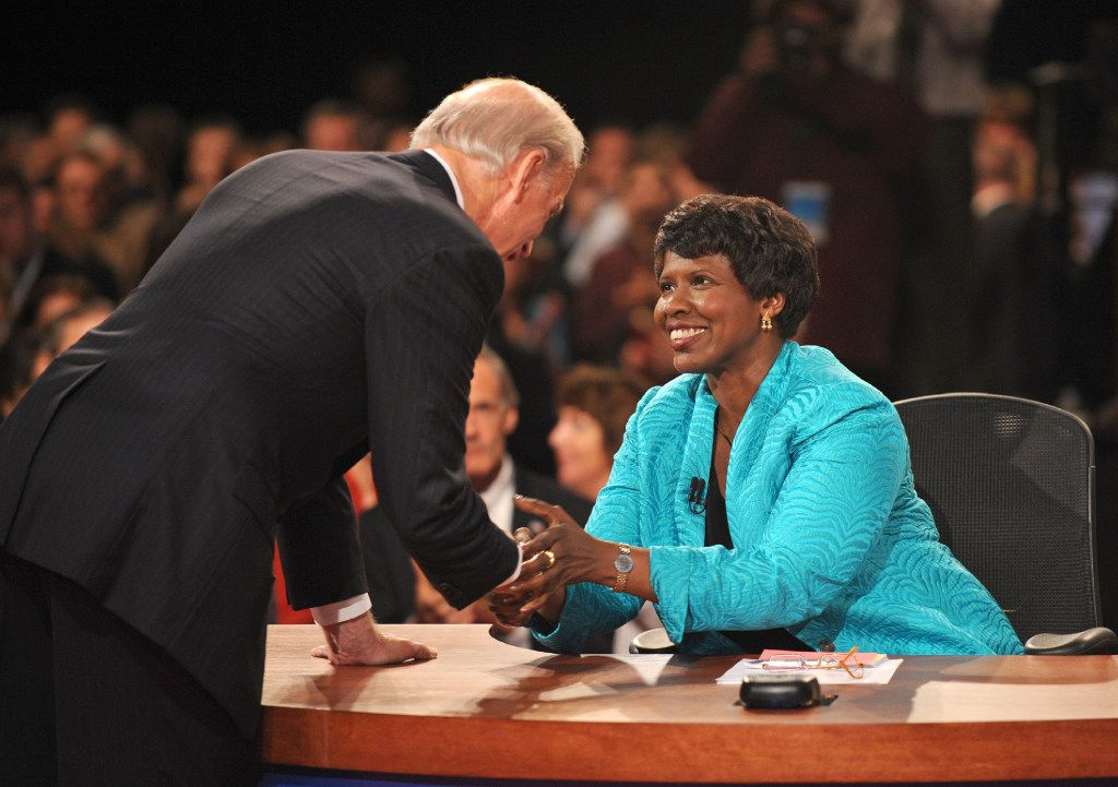 In this Oct. 2, 2008, file photo, PBS journalist and debate moderator Gwen Ifill and then-Democratic vice presidential nominee, Sen. Joe Biden, D-Del., left, shake hands at the end of his vice presidential debate with Republican rival, Alaska Gov. Sarah Palin in St. Louis, Mo. Ifill died on Monday, Nov. 14, 2016, of cancer, PBS said. She was 61.  (AP Photo/Don Emmert, File Pool)
