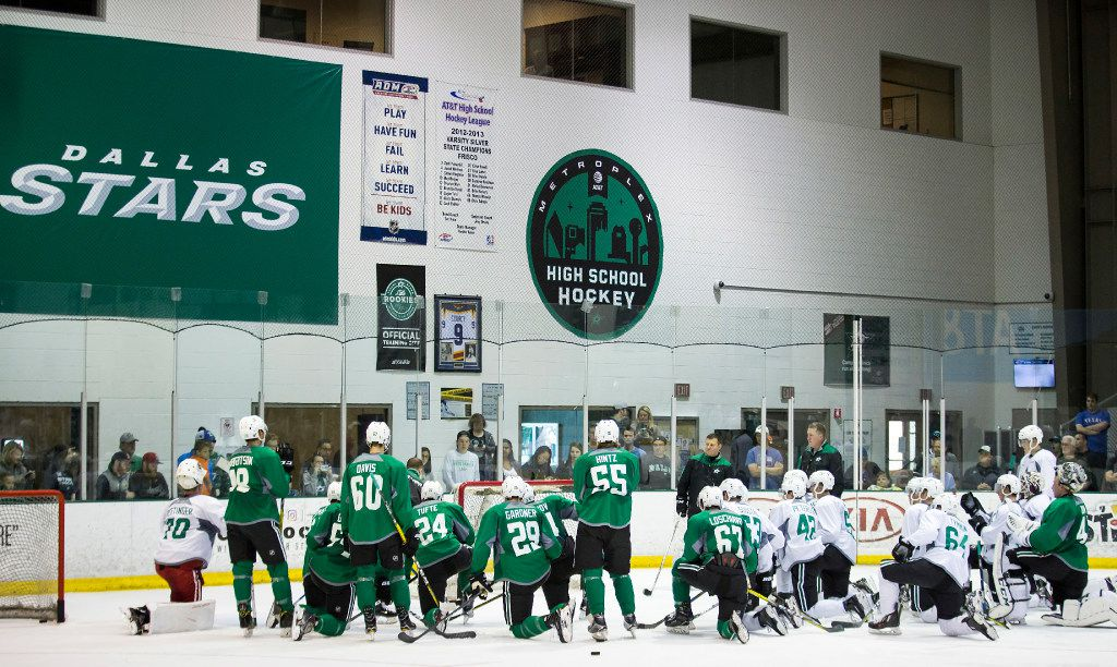 Players huddle on the ice on the first day of Dallas Stars development camp at the Dr Pepper StarCenter on Saturday, July 8, 2017, in Frisco. (Smiley N. Pool/The Dallas Morning News)