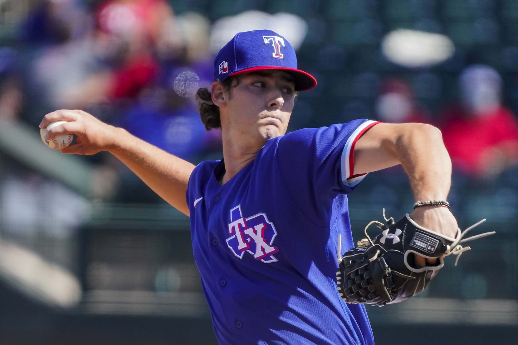 Texas Rangers pitcher Cole Winn delivers during the fifth inning of a spring training game against the Cleveland Indians at Surprise Stadium on Tuesday, March 9, 2021, in Surprise, Ariz.
