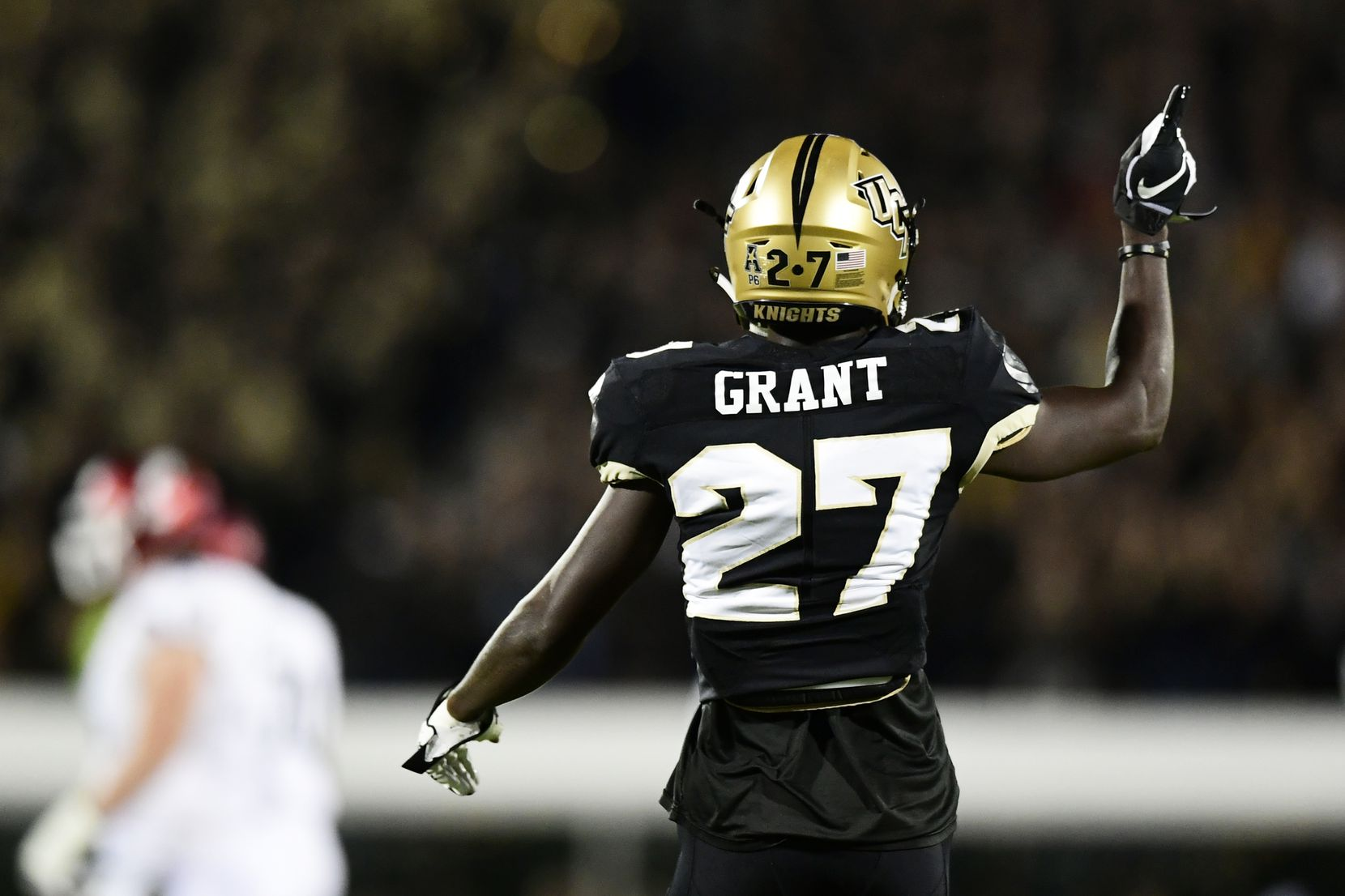 Richie Grant #27 of the UCF Knights celebrates after a tackle for a loss against the Cincinnati Bearcats on November 17, 2018 in Orlando, Florida.