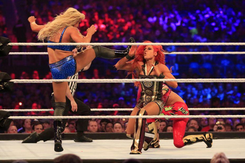 Charlotte, left, wrestles Becky Lynch, center, and Sasha Banks during WrestleMania 32 at AT&T Stadium in Arlington.