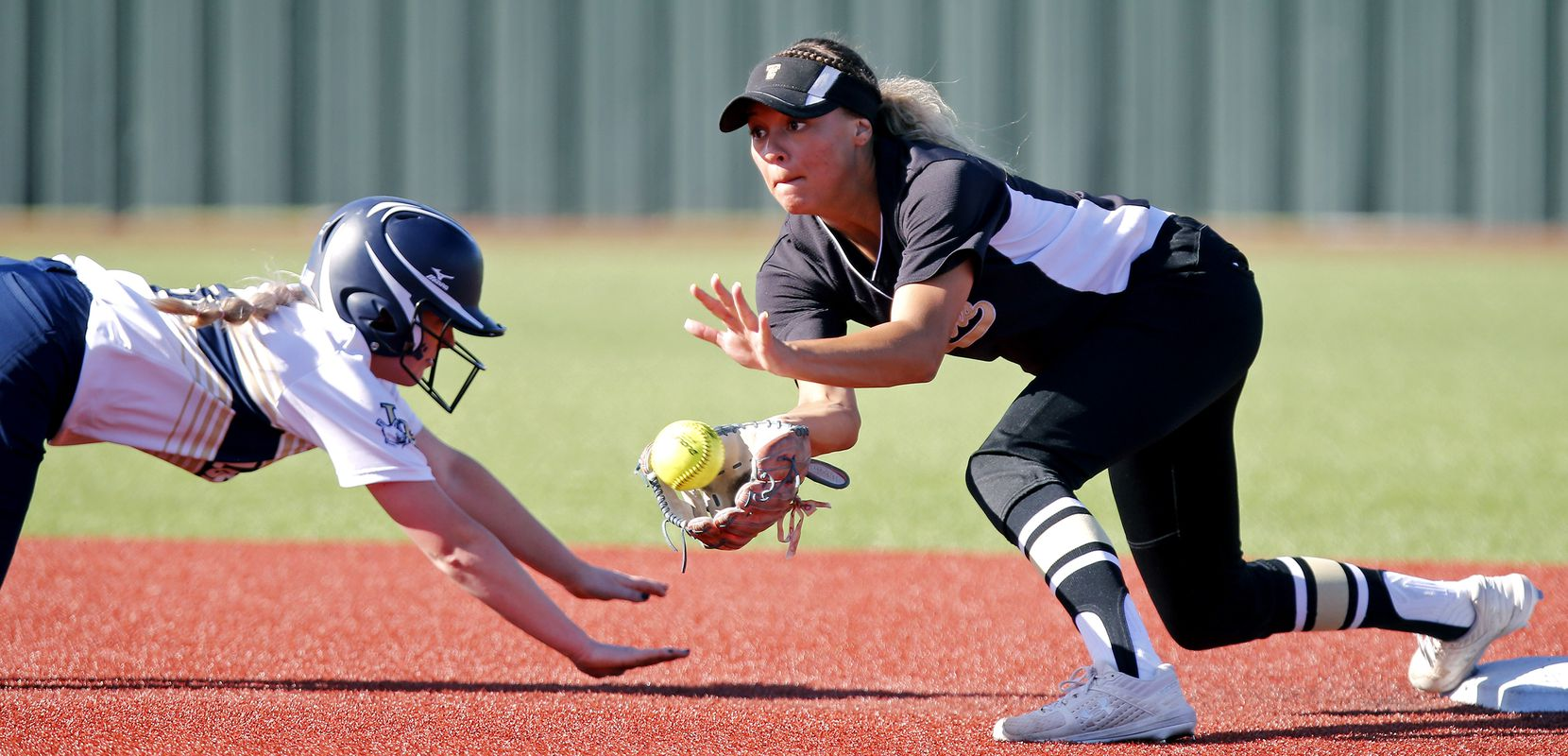 Little Elm center fielder Tatum Mowery (3) was ruled safe at second base as The Colony shortstop Jayda Coleman (10) attempts the tag on a pick off play in the third inning as The Colony High School played Little Elm High School in a playoff game held at Prosper High School on Tuesday, May 21, 2019.  (Stewart F. House/Special Contributor)
