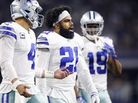 FILE - Cowboys quarterback Dak Prescott (4) talks with running back Ezekiel Elliott (21) as they walk to the huddle during a third-quarter timeout in a game against the Eagles at AT&T Stadium in Arlington on Sunday, Dec. 9, 2018.