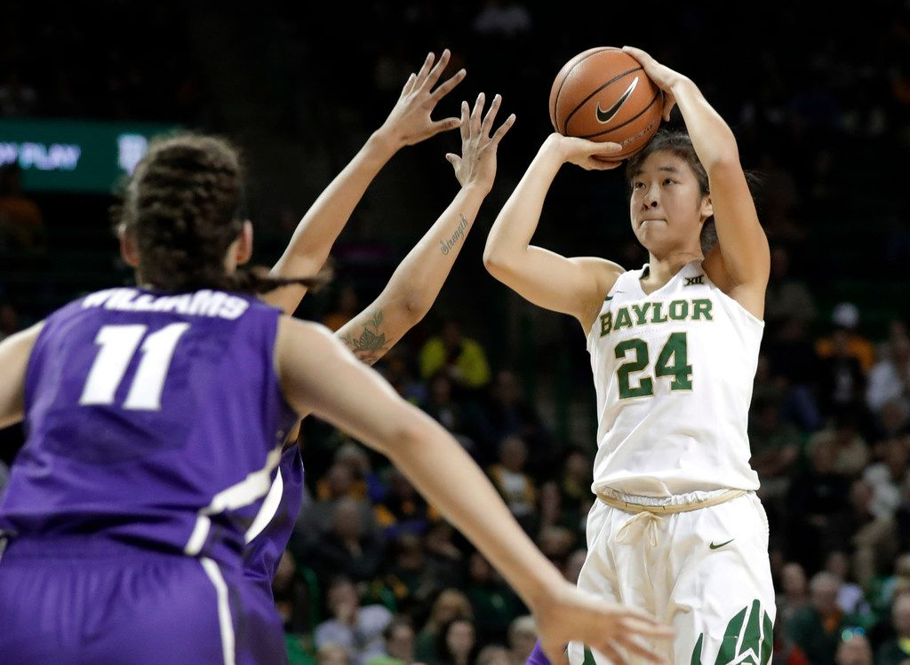 Kansas State's Peyton Williams (11) defends as Baylor's Natalie Chou (24) shoots during the second half of an NCAA college basketball game Saturday, Jan. 20, 2018, in Waco, Texas. (AP Photo/Tony Gutierrez) ORG XMIT: TXTG116