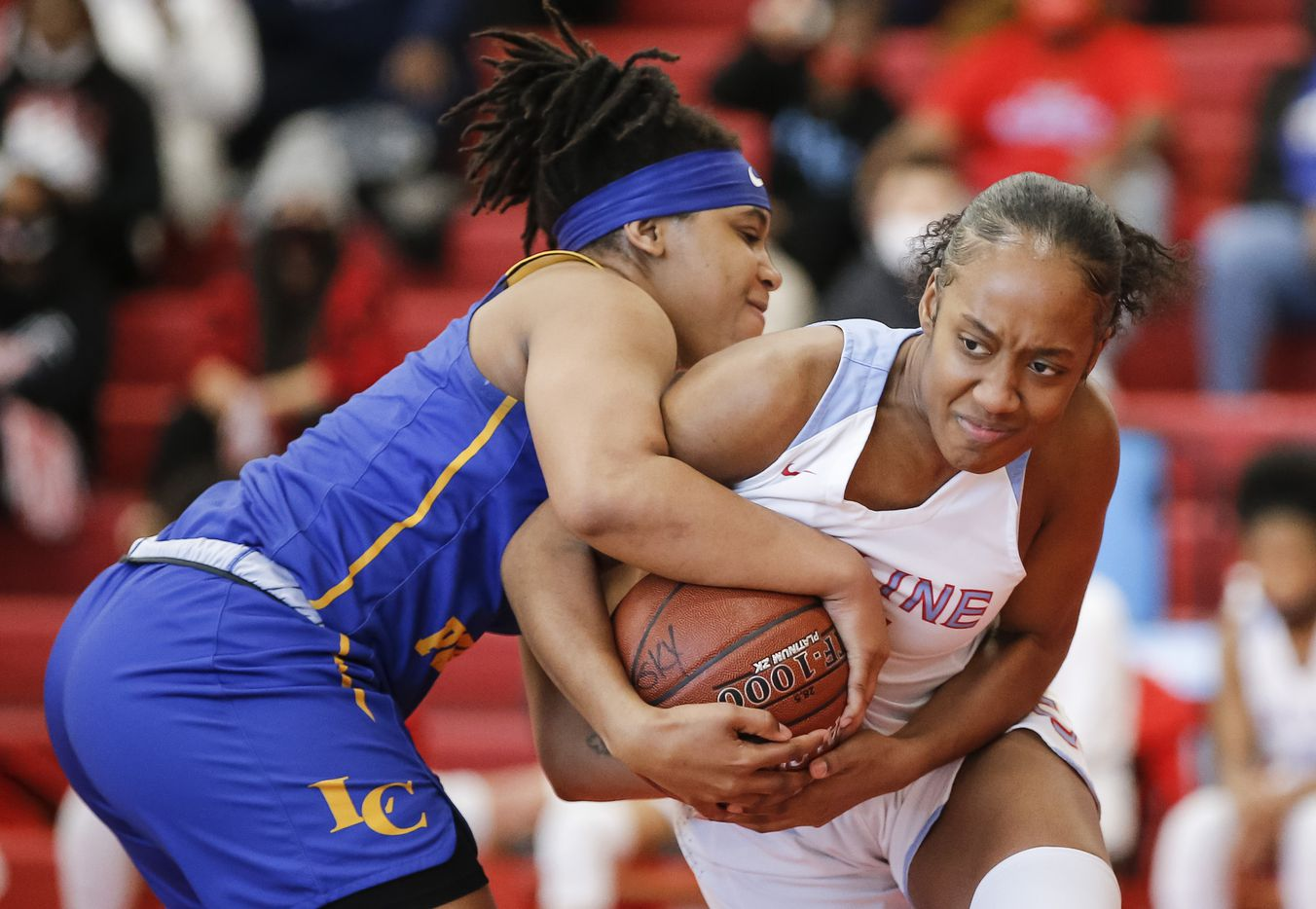 Lakeview Centennial junior Taliyah Harris, left, battles Skyline senior Taylor Copeland for the ball during a girls basketball first-round playoff game at Hillcrest High School in Dallas, Saturday, February 13, 2021. Skyline won 49-42. (Brandon Wade/Special Contributor)