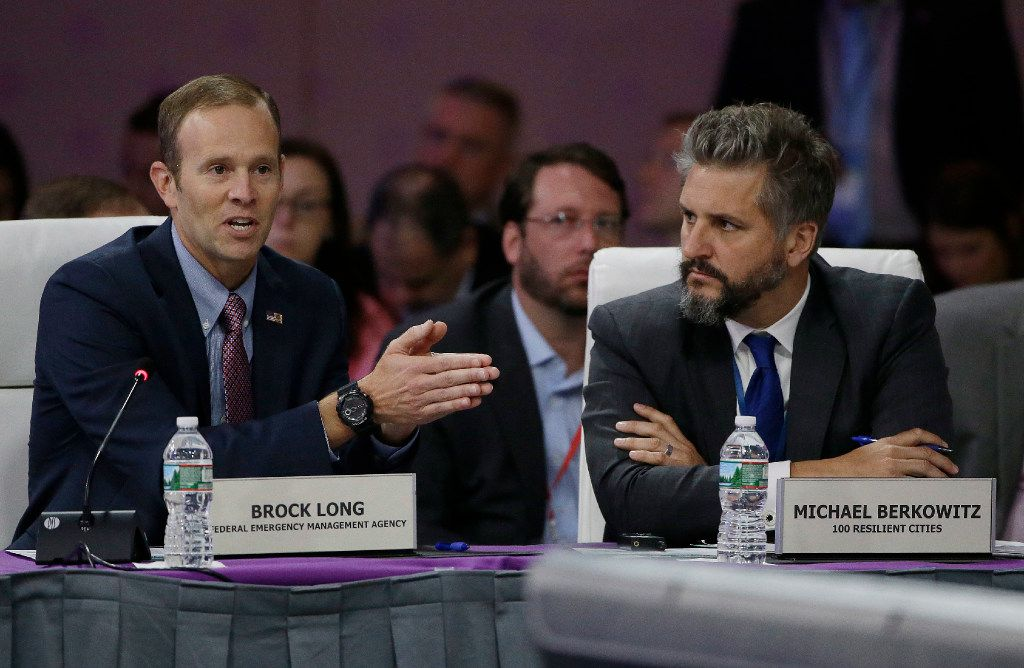 """FEMA Administrator Brock Long, left, addresses a plenary session entitled """"Preparing for the Extreme: Building Resilient Communities"""" as 100 Resilient Cities President Michael Berkowitz, right, looks on during the third day of the National Governors Association's meeting Saturday, July 15, 2017, in Providence, R.I."""