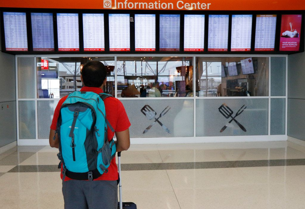 Vitesh Bhakta of Dallas, checks the flight information board in the newly remolded Terminal E at s Fort Worth International Airport on Wednesday, August 23, 2017. Today marks the second completed terminal in DFW's $2.7 billion Terminal Renewal and Improvement Program to renovate three of it's original terminal buildings. (David Woo/The Dallas Morning News)