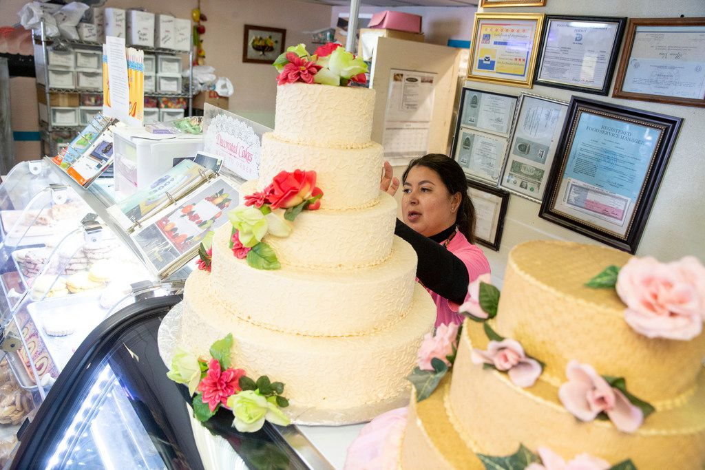 Naomi Vera Chavarria helps customers purchase a cake at Vera's Bakery Inc. in Dallas on Nov. 13, 2018.