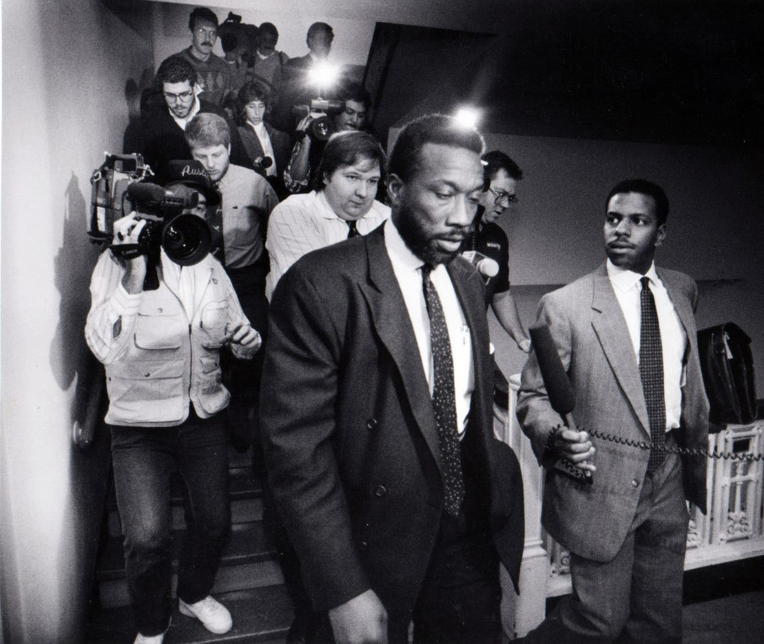 November, 1990 - John Wiley Price leaves the Police Department's crimes against persons division after meeting with detectives. The Dallas County Commissioner turned over a gun he said he had during a confrontation with an off-duty officer.