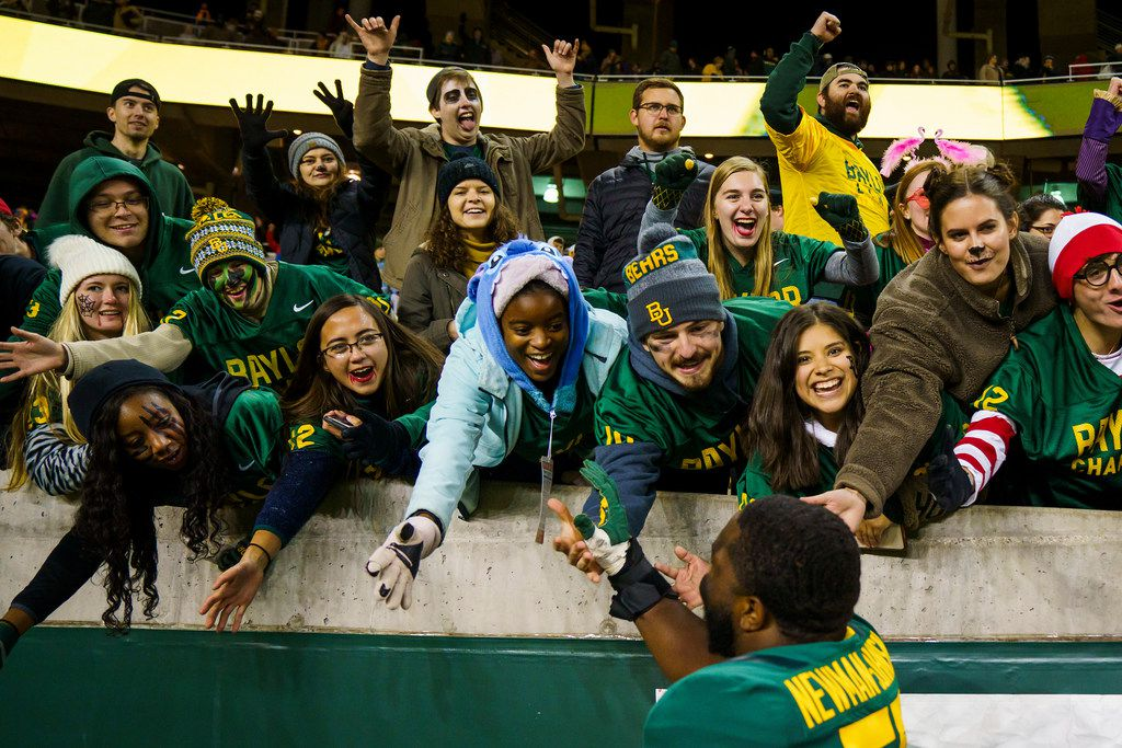 Baylor offensive lineman Xavier Newman (55) celebrates with fans after a victory over West Virginia in an NCAA football game at McLane Stadium on Thursday, Oct. 31, 2019, in Waco, Texas.
