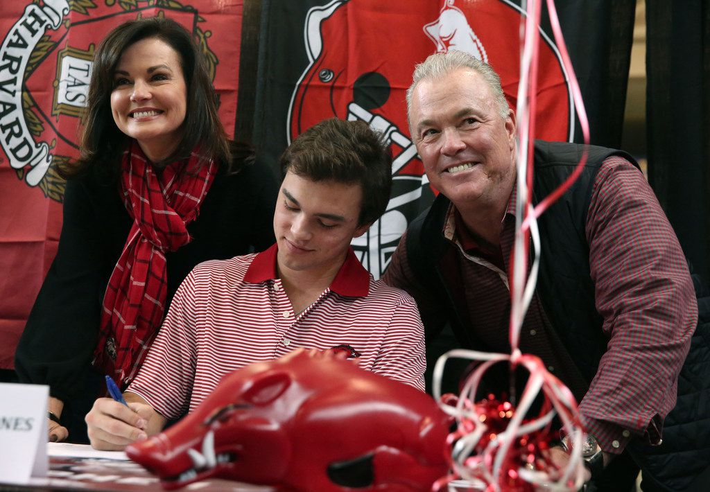 Stephen and Karen Jones pose for a photograph with their son, Highland Park quarterback John Stephen Jones, during Highland Park High School's National Signing Day ceremony at the school in Dallas on Wednesday, Feb. 7, 2018. (Rose Baca/The Dallas Morning News)
