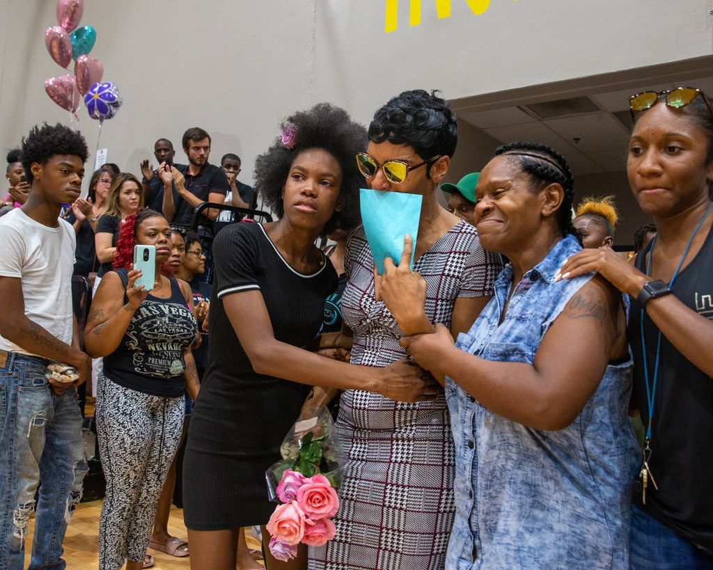 Sontravia Elder (center), Tonya Elder (second from right) and their immediate family enter a vigil to remember the life of 9-year-old Brandoniya Bennett at the Roseland Townhomes on Aug. 16, 2019. Bennett was killed when someone fired into an apartment Wednesday in Old East Dallas, police say.
