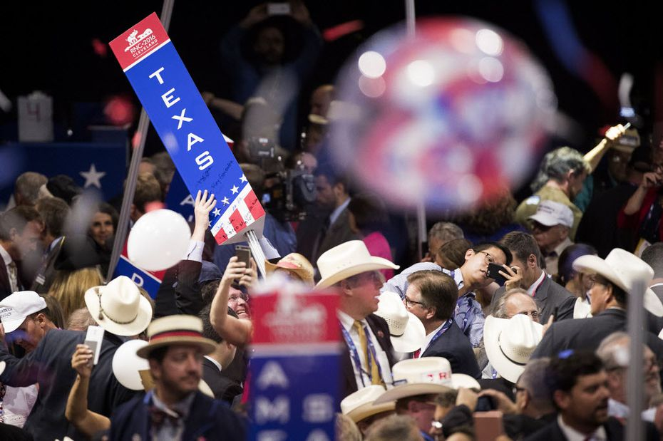 Members of the Texas delegation take down their state sign at the conclusion of the Republican National Convention on Thursday, July 21, 2016, in Cleveland.