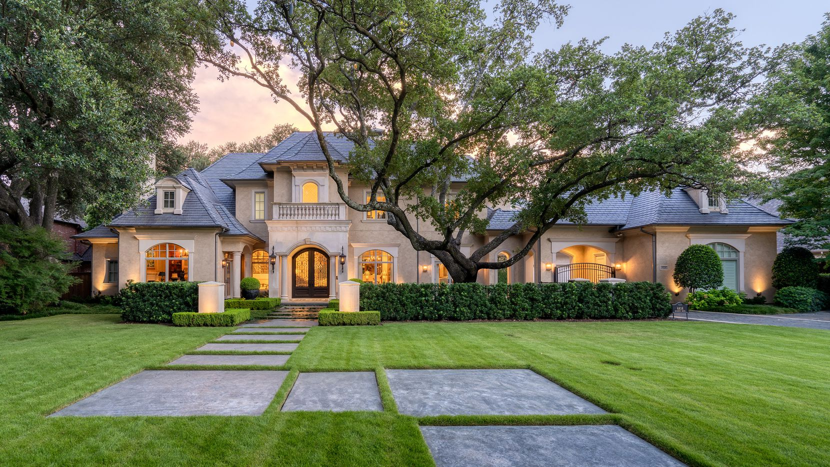 The home at 4414 Woodfin Drive in Preston Hollow has four bedrooms and a resort-like outdoor living space.