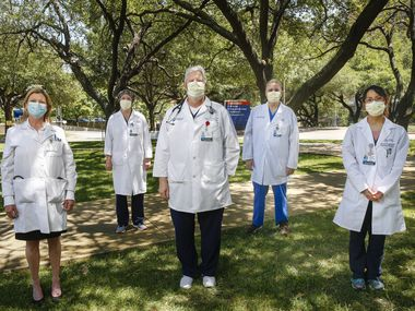 (Left to right) Dr. Donna Casey, Dr.  Allison Liddell, Dr. Gary Weinstein, Clinical Nurse Leader Doug Johnson and Dr. Marika Harada pose for a photograph Thursday, April 23, 2020 at Texas Health Presbyterian Hospital Dallas. The medical team worked to save the life of a COVID-19 patient who had been on life support for a month.