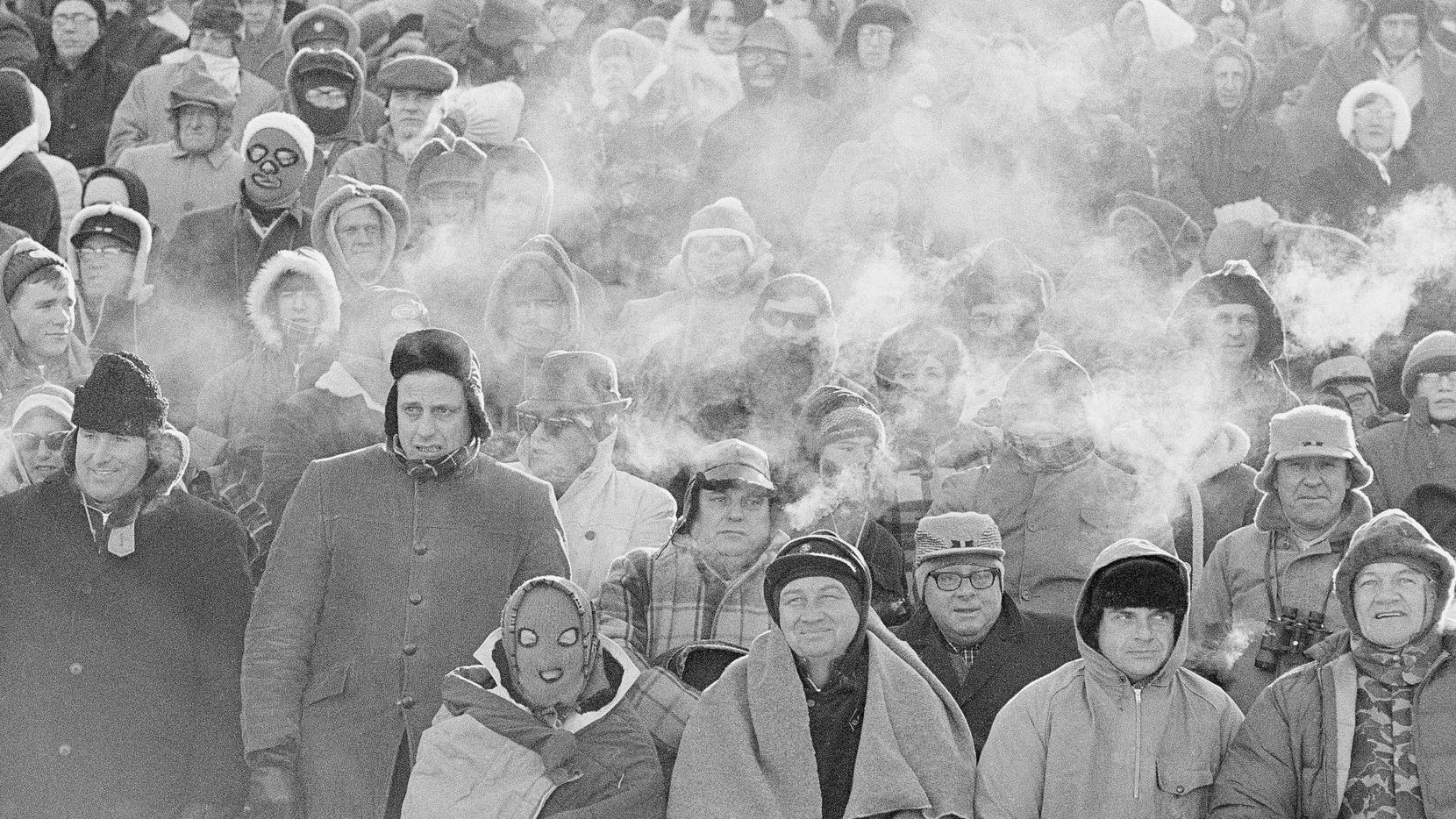 FILE - In this Dec. 31, 1967 file photo, fans watch the Green Bay Packers play the Dallas Cowboys in the NFL Championship game in Green Bay, Wisc. Comparisons to the legendary 1967 Ice Bowl are inevitable when the mercury dips below zero at Lambeau Field.