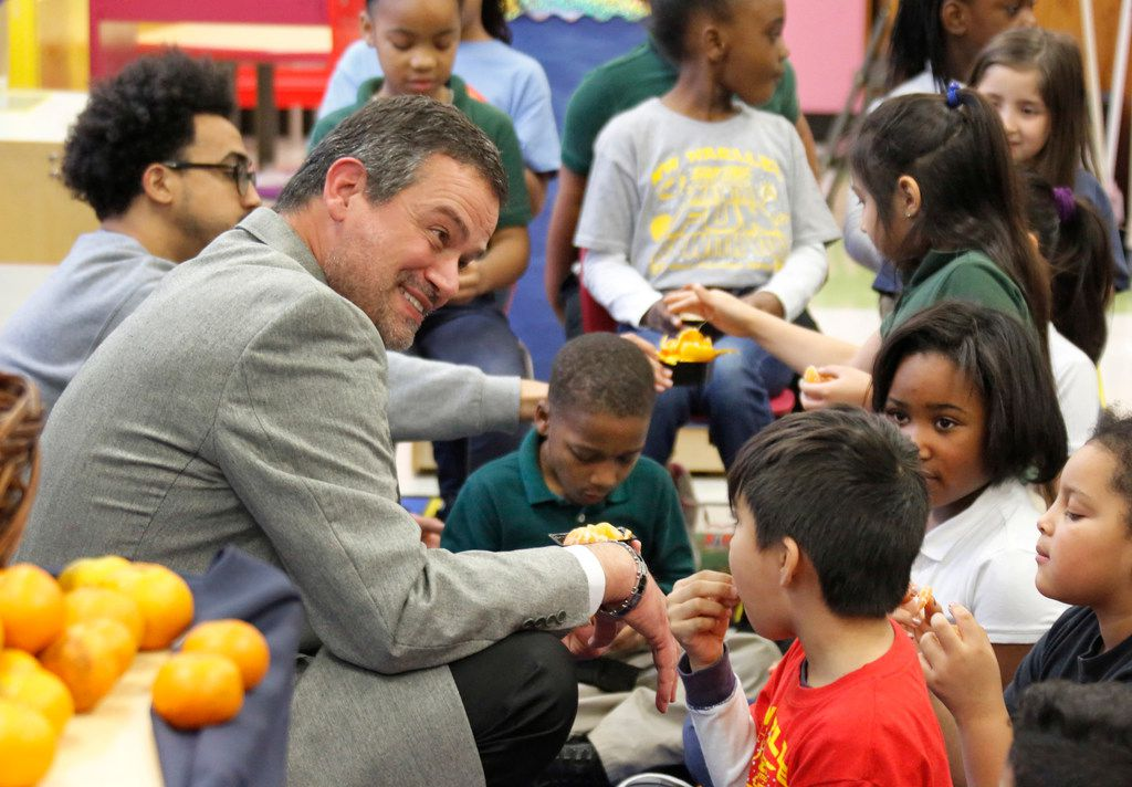 Michael Rosenberger, DISD director of food and child nutrition services visits with students at N.W. Harllee Early Childhood Center in Dallas as they sample locally-sourced Satsuma oranges.