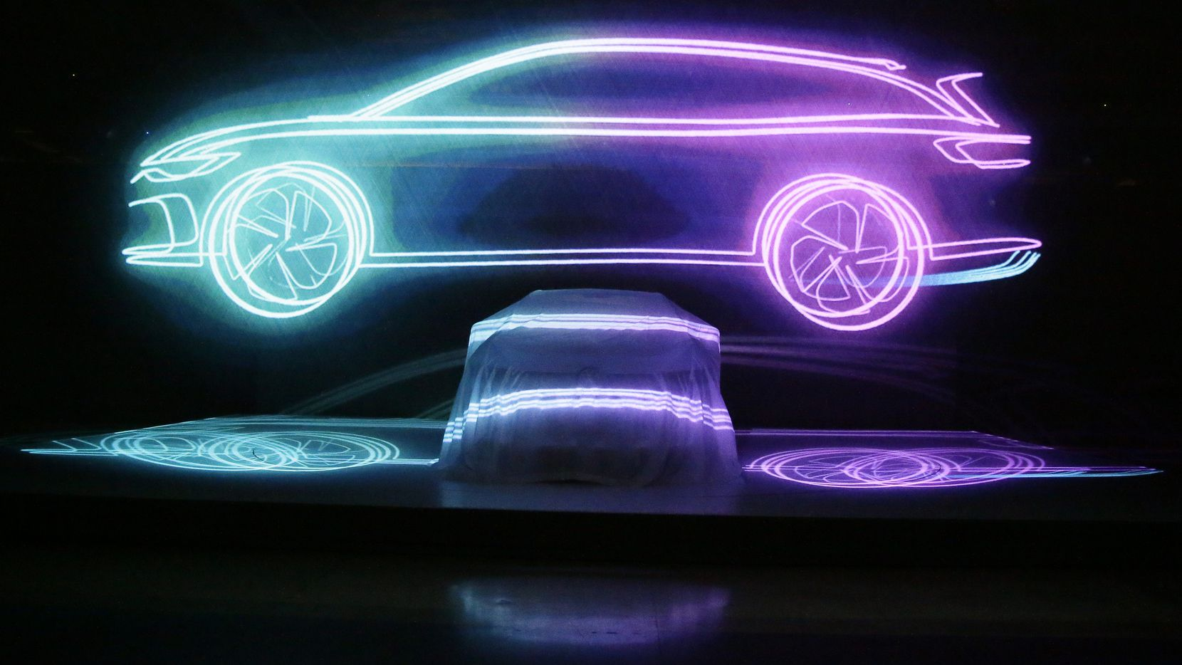 Volkswagen unveiled its I.D. Space Vizzion autonomous electric concept car in Los Angeles Nov. 19. Scott Burns says a shift to electric vehicles is more important than going back to the moon.