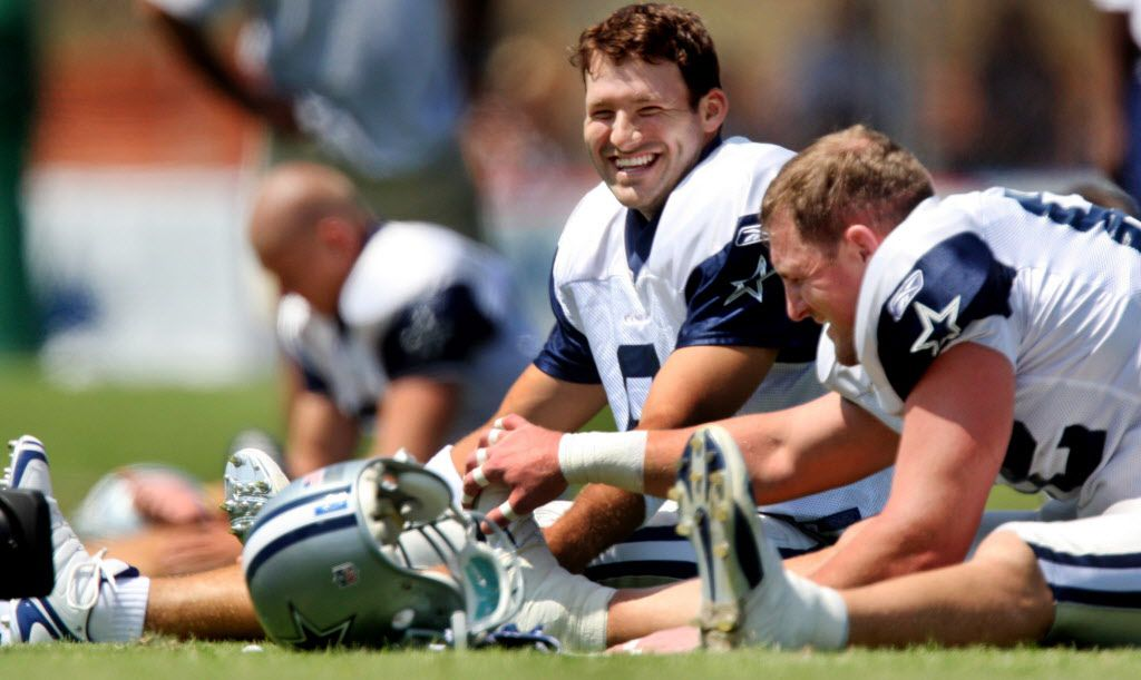 """Former quarterback Tony Romo and tight end Jason Witten speaking while stretching prior to a training camp session in 2008. """"pictured here"""""""