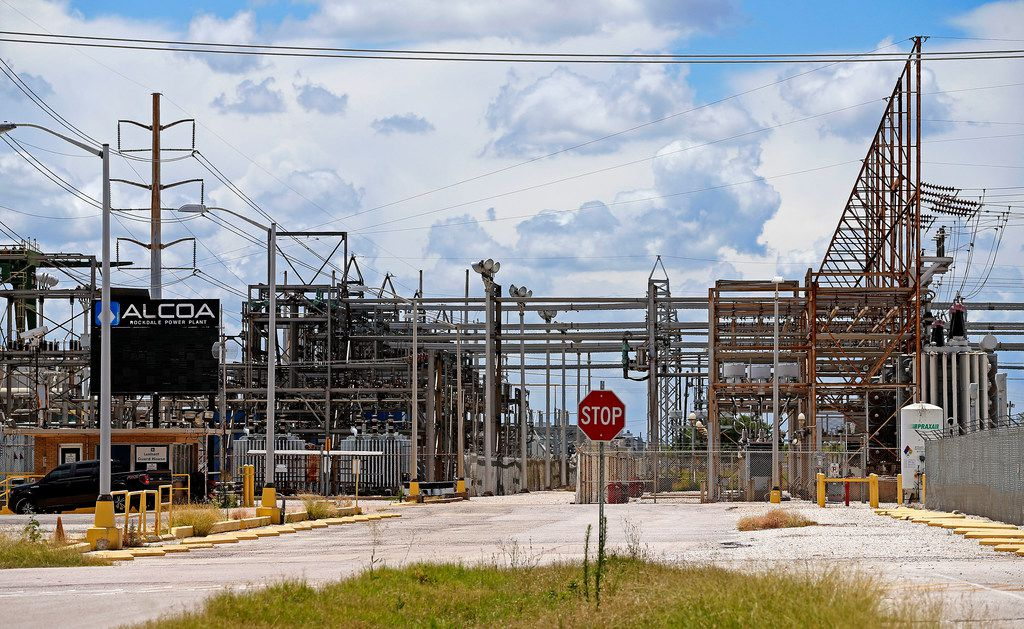 A sign of the old Alcoa Rockdale Power Plant at the former coal-fired Sandow power plant near Rockdale, Texas, on Thursday, June 14, 2018. The electric generating power plant owned by a subsidiary of Luminant was shut down in 2018.