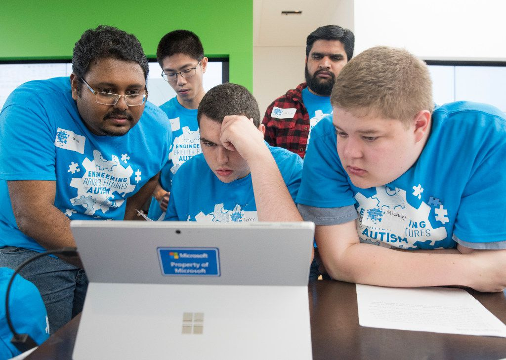 Akshay Potnuru, left, Qian Ye, rear left, and Lokesh Saharan, all UTD graduate students help Terry Wood, center, and Michael Susens design a part for a wind turbine during the Engineering Brighter Futures for Autism event at the Microsoft Store in NorthPark Center on Saturday, April 29, 2017.  (Rex C. Curry/Special Contributor)