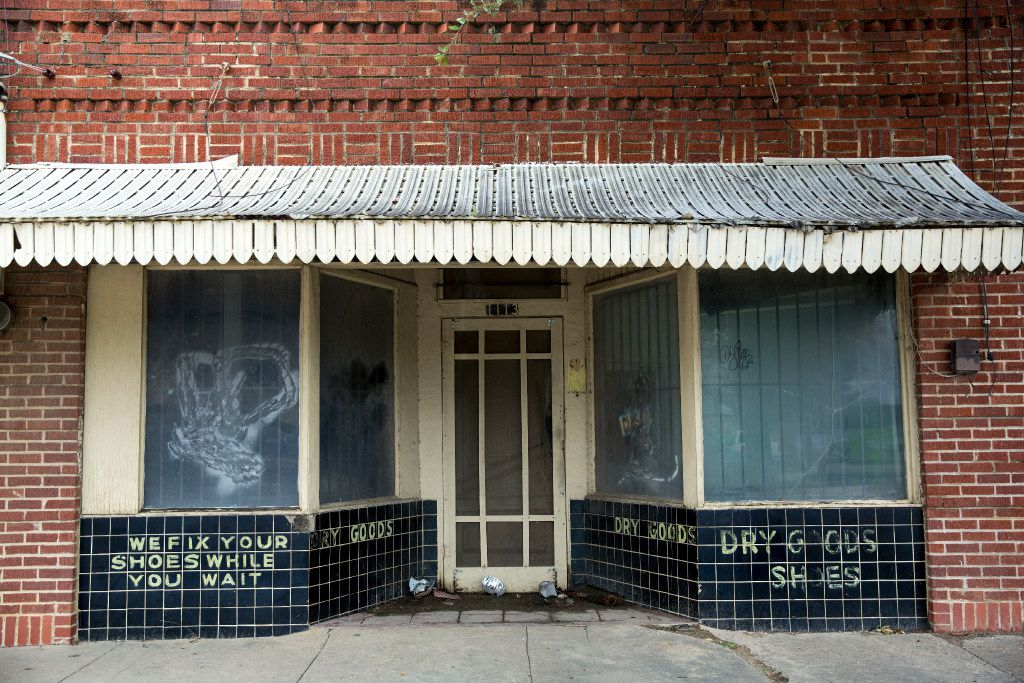 A closed cobbler's shop in the 1100 block of Singleton Boulevard shows the past commercial life of small businesses in the little economy of West Dallas. (G.J.McCarthy/Staff Photographer)