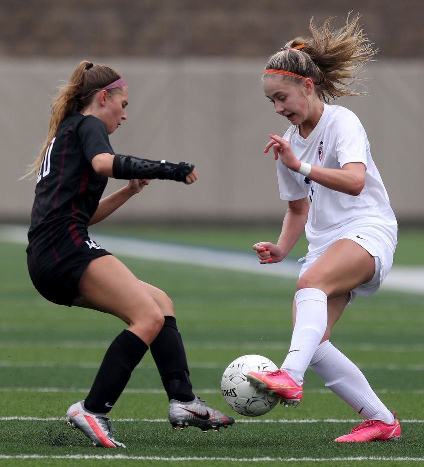 Dripping Springs' Kaleigh Howell (20) and Wakeland's Bella James (3) struggle for control of the ball during their UIL 5A girls State championship soccer game at Birkelbach Field on April 16, 2021 in Georgetown, Texas.  (Thao Nguyen/Special Contributor)