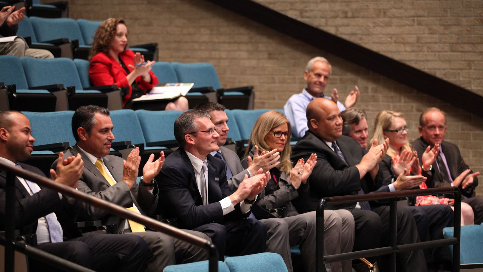 Toyota representatives, in the front row, applauded after a vote for an economic incentive package for the company during a session of the Plano City Council on Monday.