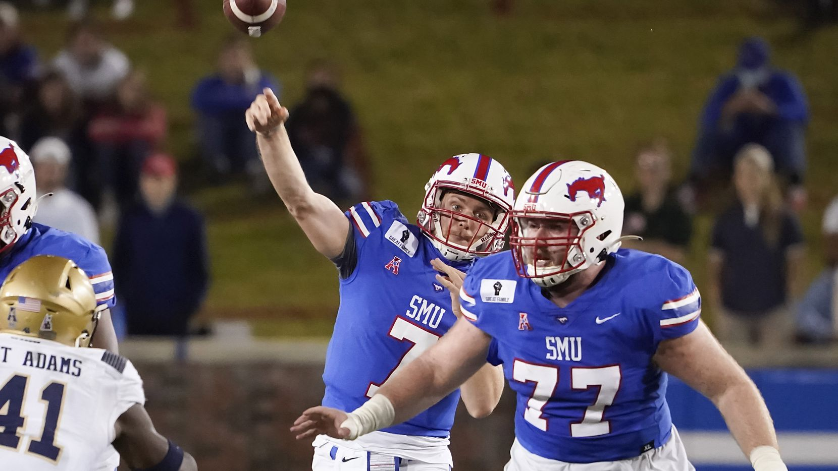 SMU quarterback Shane Buechele (7) throws a pass behind the protection of SMU offensive lineman Alan Ali (77) during the second quarter of an NCAA football game against Navy at Ford Stadium on Saturday, Oct. 31, 2020, in Dallas. (Smiley N. Pool/The Dallas Morning News)