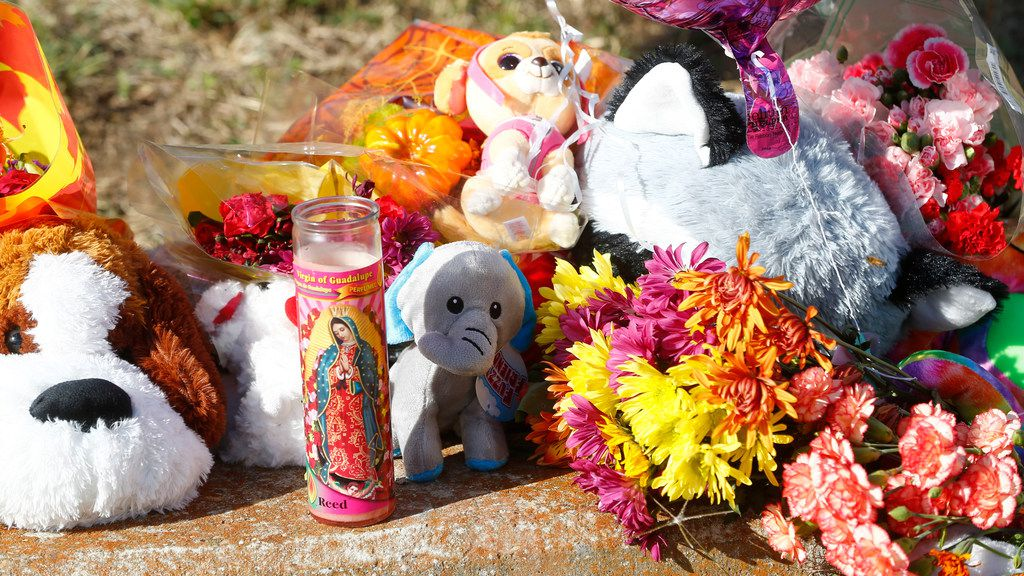 Stuffed animals and candles mark the ditch where the body of Sherin Mathews was found.
