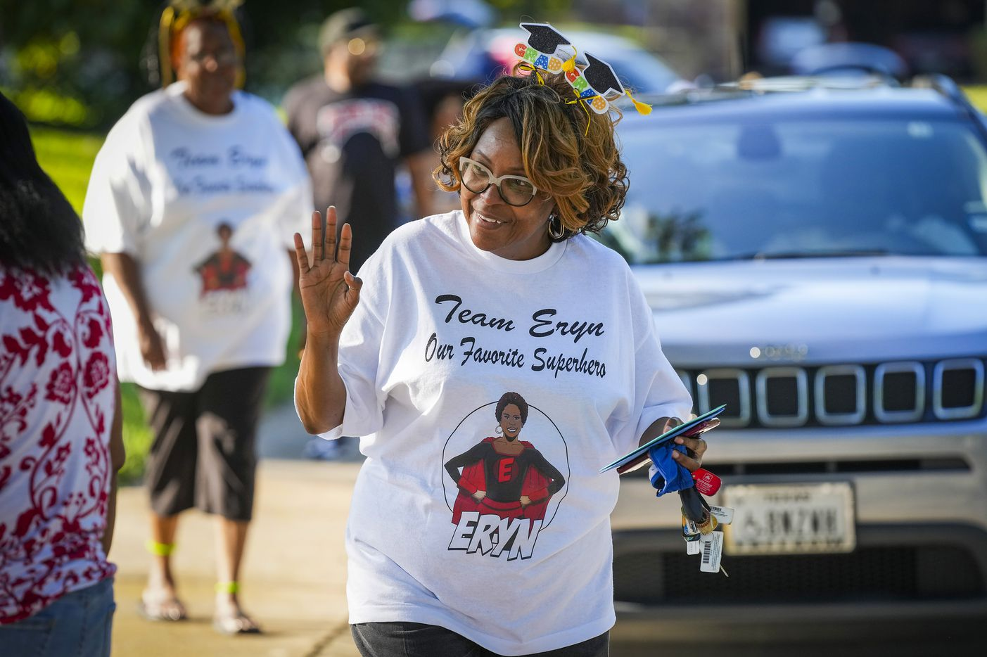 Kay Johnson wears a t-shirt in support as she waves to her niece Eryn Fayson as well wishers arrive to celebrate Eryn's graduation from Booker T. Washington HSPVA on Saturday, June 19, 2021.