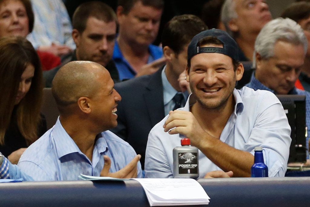 Former Dallas Cowboys players Miles Austin and Tony Romo laughing during the second half of play at American Airlines Center in Dallas on Wednesday, December 20, 2017. Dallas Mavericks defeated the Detroit Pistons 110-93. (Vernon Bryant/The Dallas Morning News)