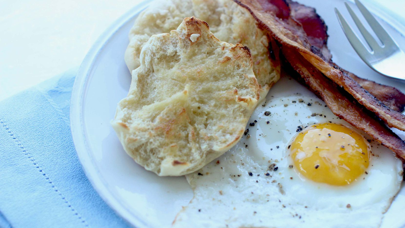 This Aug. 3, 2015 photo shows English muffins with eggs and bacon in Concord, N.H. (AP Photo/Matthew Mead)