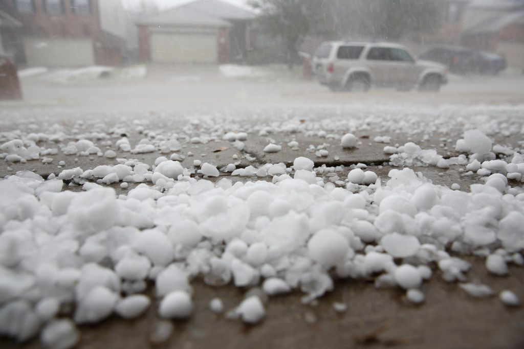 Hail pounded houses and cars in the City of McKinney as a severe storm passed through on Sunday, March 24, 2019. (Brian Elledge/The Dallas Morning News)