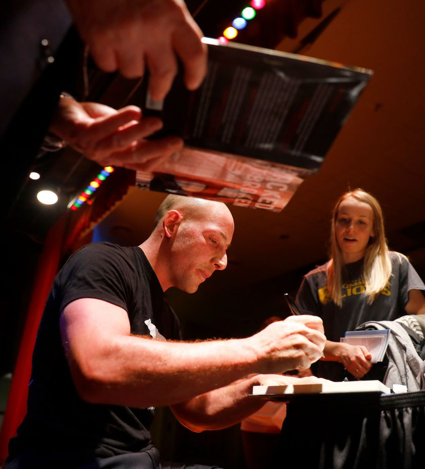 Suicide survivor Kevin Hines signs copies of his book,  Cracked Not Broken, for students following his keynote address at Texas A&M University Commerce.