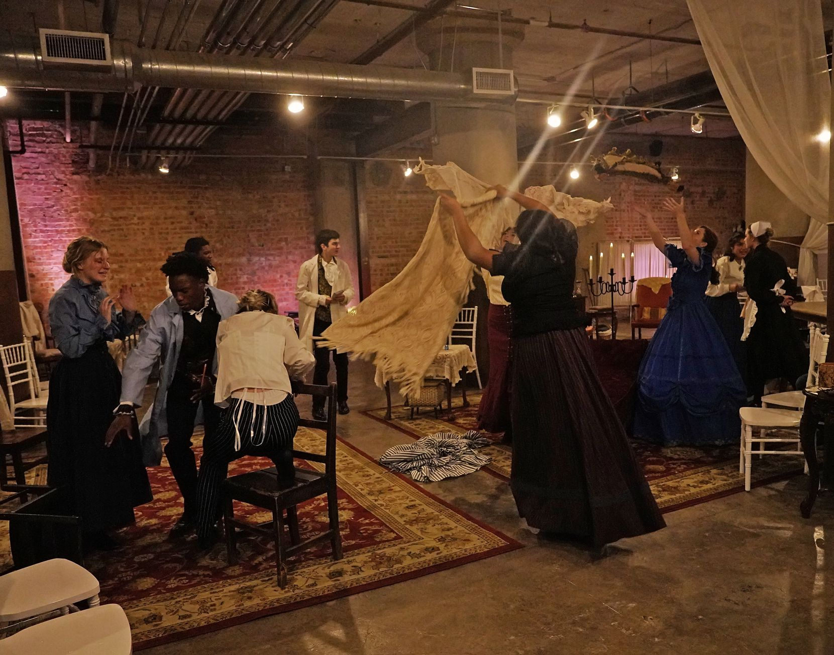 """The cast of Cry Havoc Theater Company's """"Committed: Mad Women of the Asylum"""" performs on the show's opening night at Southside on Lamar."""