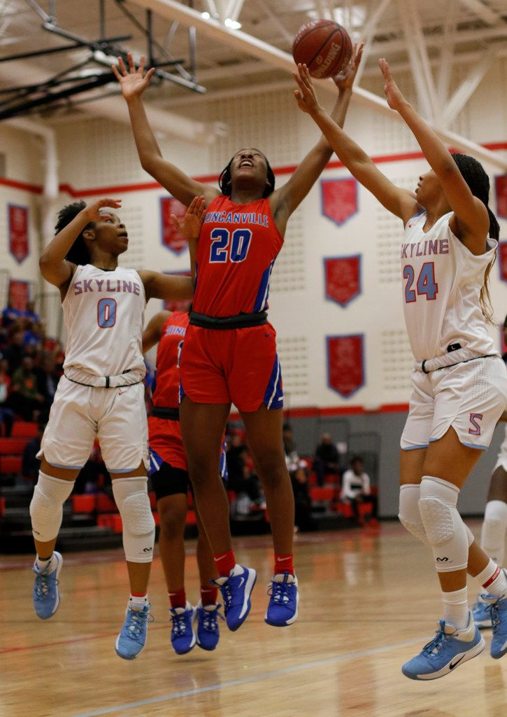 Duncanville's Anaya Bernard (20) battles Dallas Skyline's Zyniah Thomas (0) and Franchesca Jennings (24) for a rebound during first half action. The two teams played their girls basketball game at Skyline High School in Dallas on January 7, 2020. (Steve Hamm/ Special Contributor)