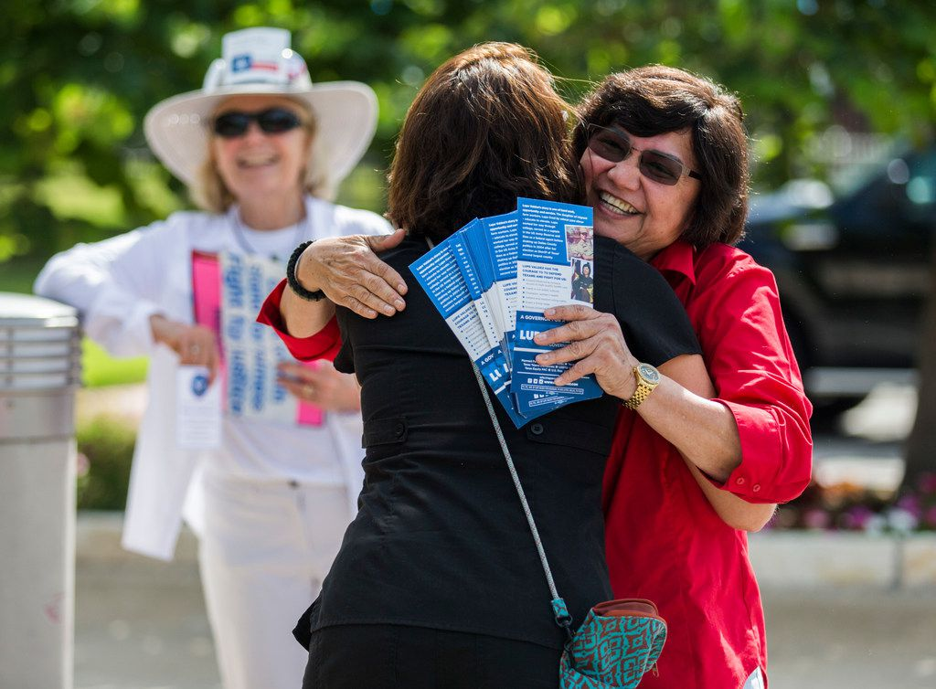 Gubernatorial candidate and former Dallas County Sheriff Lupe Valdez (right) greeted supporter Samantha Kaylor outside a polling place at Walnut Hill Recreation Center in Dallas on Tuesday.