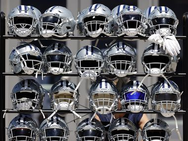 A rack of helmets are pictured following Training Camp practice at The Star in Frisco, Texas, Tuesday, August 24, 2021.