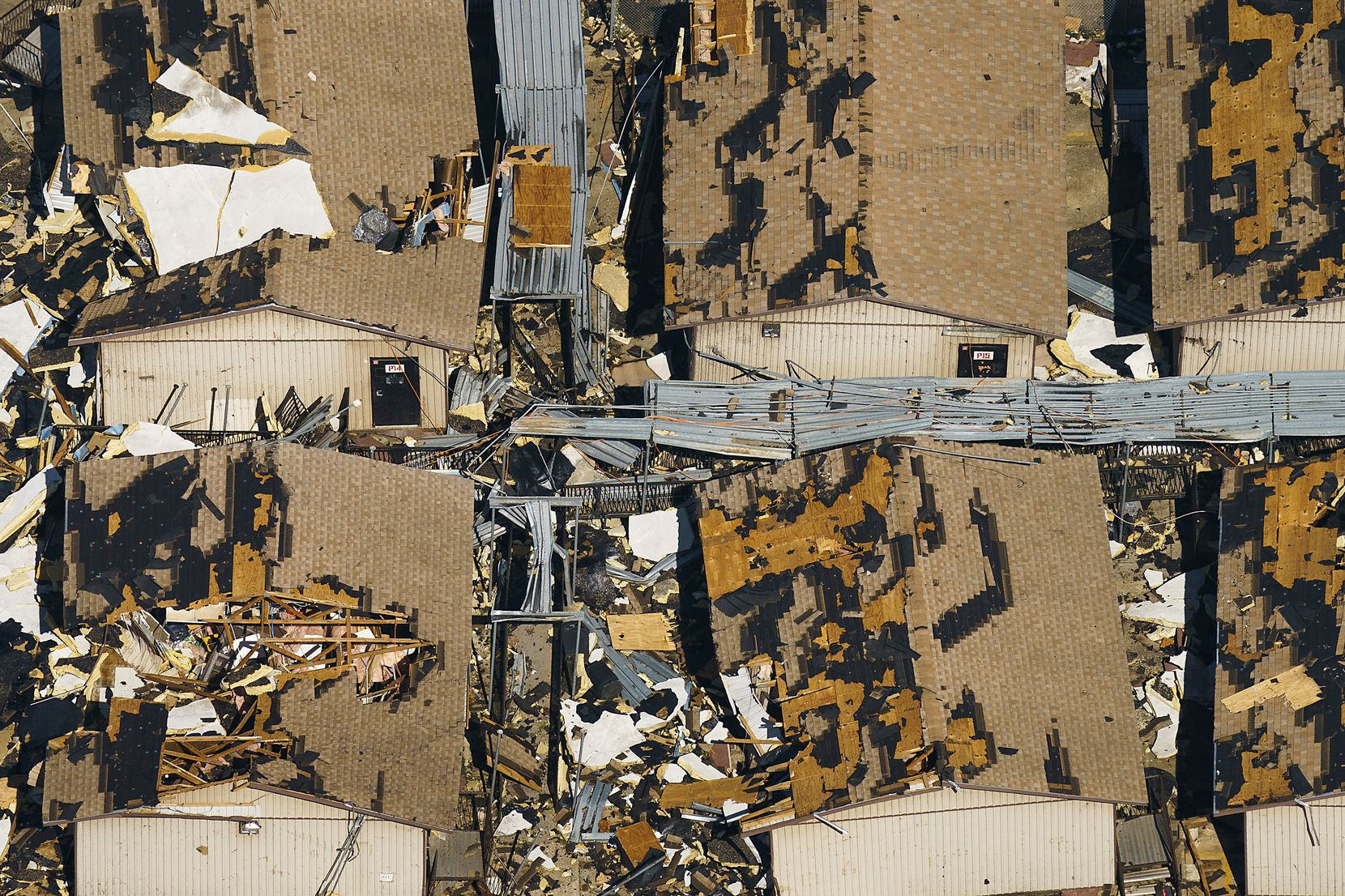 Temporary classroom are seen buried in rubble at Thomas Jefferson High School on Monday, Oct. 21, 2019, in Dallas.