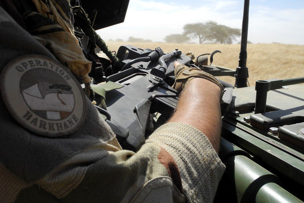 In this photo taken on Nov. 1, 2017, a soldier of France's Barkhane mission bearing the insignia 'Barkhane operation' holds a weapon as he patrols in central Mali, in the border zone with Burkina Faso and Niger as a joint anti-jihadist force linking countries in the Sahel began operations on Nov. 1.  Two French soldiers were killed and another was hurt when their armoured vehicle struck a mine in Mali, a military source told AFP on Feb. 21, 2018. Around 4,000 French troops are deployed in Mali and neighboring countries to combat jihadists.