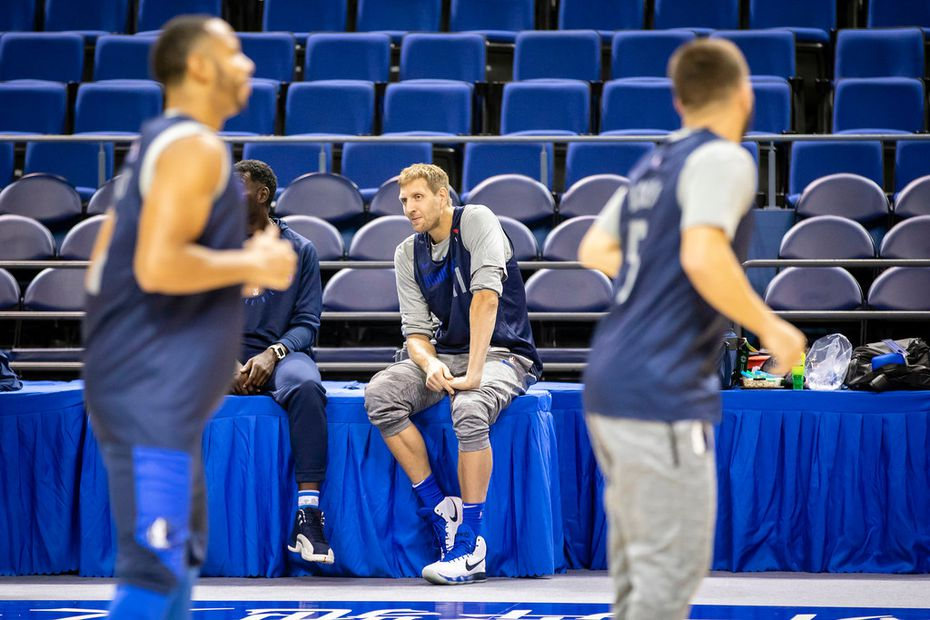 Dallas Mavericks forward Dirk Nowitzki (41) watches teammates guard Devin Harris (left) and guard J.J. Barea (right) as they stretch before practice at Mercedes-Benz Arena on Wednesday, Oct. 3, 2018, in Shanghai. The Mavericks will face the Philadelphia 76ers in Shanghai on Oct. 5th in the first of two NBA China Games 2018 preseason basketball games. (Smiley N. Pool/The Dallas Morning News)