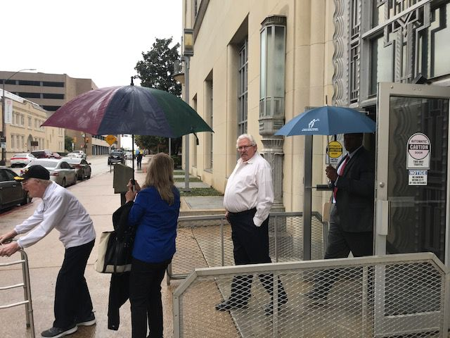 Glenn Halfin (center) leaves the federal courthouse in Fort Worth after being sentenced to a year in prison for hanging a black baby doll in front of his African American neighbors' apartment.